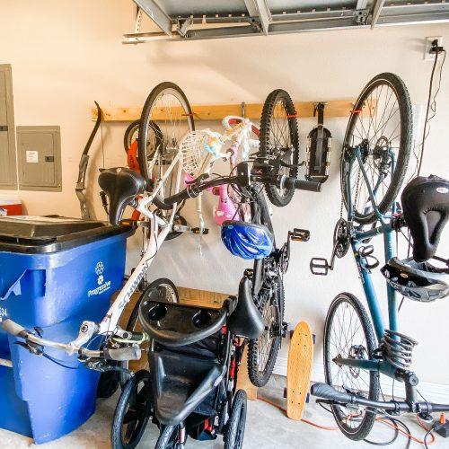 Clean, organized garage with bikes, sports