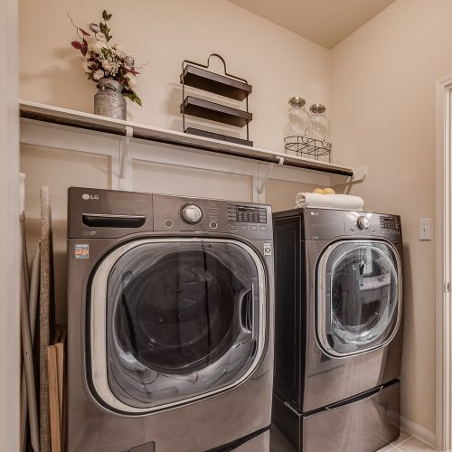 Clean and organized laundry room for staging and selling home